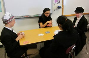 7/8 students play Whist during their in-character Victorian tea.