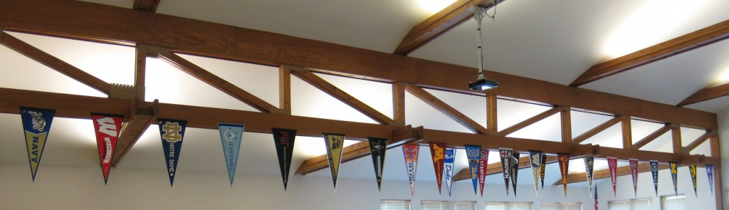 Alumni pennants line the rafters of the Commons.